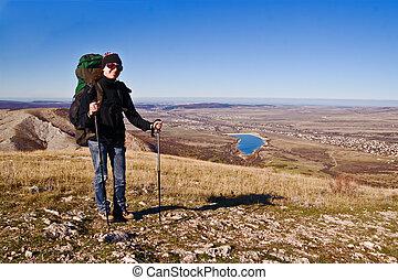 Hiker girl on the mountain summit