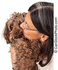 Woman Kissing Dog Companion - A woman shelter volunteer...