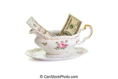 Vintage porcelain sauce-boat with dollar bills isolated