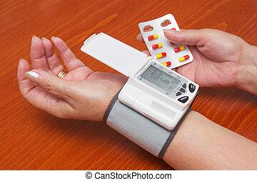 Blood Pressure Meter on Adult Woman Wrist.