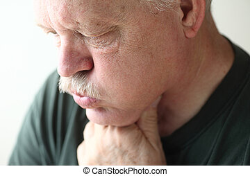Senior man with reflux