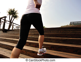 woman running up on wooden stairs