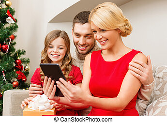 smiling family with tablet pc - family, christmas,...