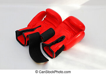 A pair of red boxing gloves Sports equipment for martial...