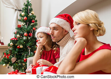 depressed family at home with many gift boxes - family,...