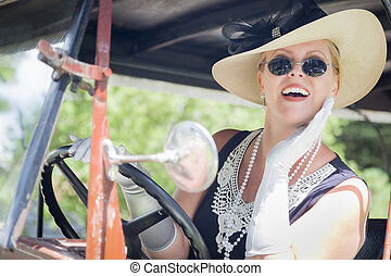 Attractive Woman in Twenties Outfit Driving an Antique...