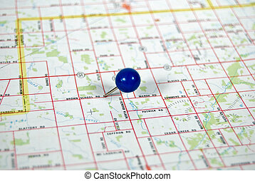 You Are Here - Blue ball pin stuck in a road map.