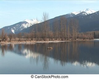 Lake with mountain reflection - Reflection of snow capped...