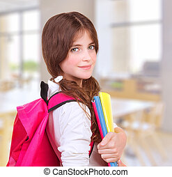 Cute girl at school - Side view of cute teen girl standing...