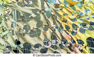 Texture military camouflage nets on day time image