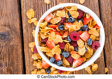 Cornflakes and different Berries (Strawberries, Blueberries...