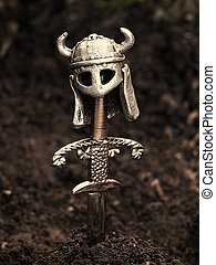 Vikings grave - Warriors grave with a sword and helmet...