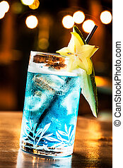 Blue cocktail - Cold blue cocktail in a night party.