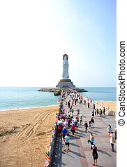 goddess of mercy statue at seaside in nanshan temple, hainan...
