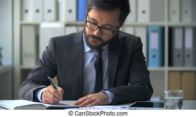 Financial Analysis - Businessman busy with paperwork