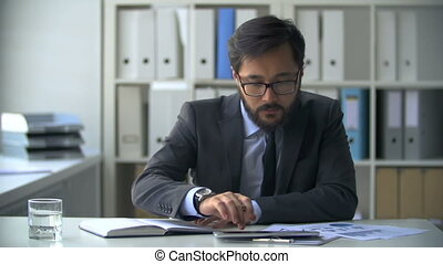 Financial Audit - Asian businessman at the office desk...