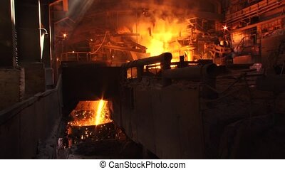 Foundry, inside view - The molten metal, sparks, casting,...