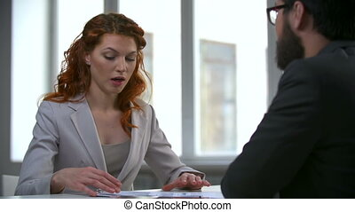 Final Report - Woman presenting financial report to her boss