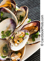 Cooked clams - Closeup of some cooked clams with parsley and...