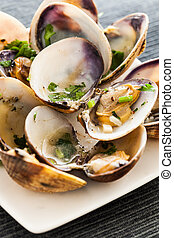 Cooked clams - Fresh cooked clams with parsley and garlic,...