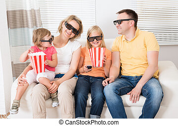Young Family Watching 3D TV