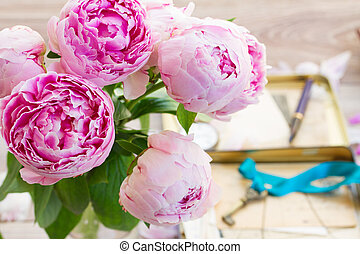 pink peonies - bouquet of fresh pink peonies in vase on...