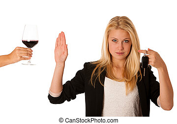 beautiful blond woman gesturing don't drink and drive gesture, w