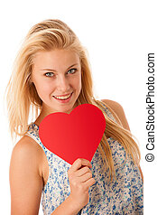 Beautiful young blonde woman with blue eyes holding red hart...