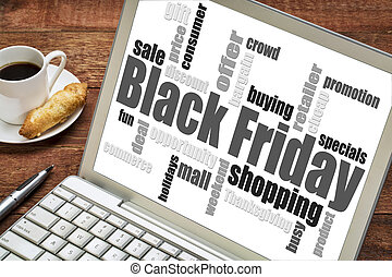 Black Friday shopping word cloud on a laprop computer with a...