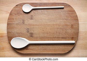 wooden cutlery on cutting board