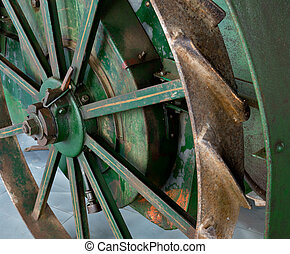 wheel of tractor - a detail of old rusty tractor wheel