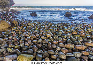 The Arches, Newfoundland west coast - smooth stones at The...