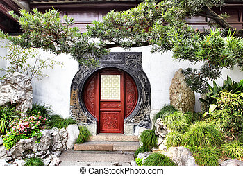 Yu Yuan Garden - Round doorway in ancient Yu Yuan Garden in...