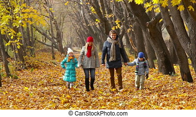 In the Woods - Family of four strolling along the lane...