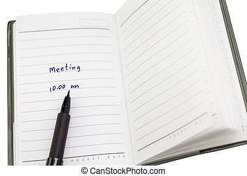 """Note - write note """"meeting"""" on notebook with pen for notes"""