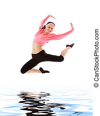 jump - picture of happy girl jumping over water