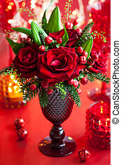 Christmas table decoration with flowers and candles