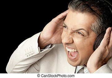 Businessman listening loud music