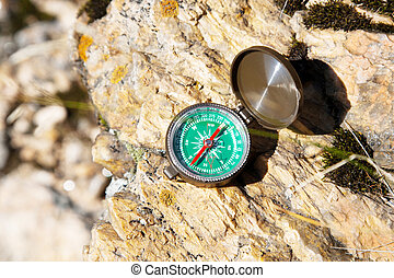 Analogic Compass Abandoned on the Rocks in the summer