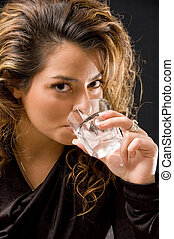 Attractive feminin drinking wine