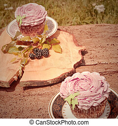 Cupcakes vintage pastel tone - cupcakes on old wooden table,...