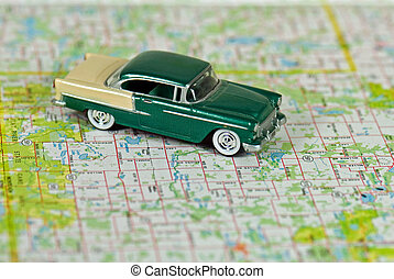 Plan Ahead - Vintage car on a road map