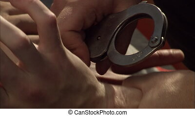 Handcuffs 1 - Criminal detention, close of an criminals...