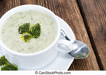 Homemade Broccoli Soup in a small bowl on wooden background