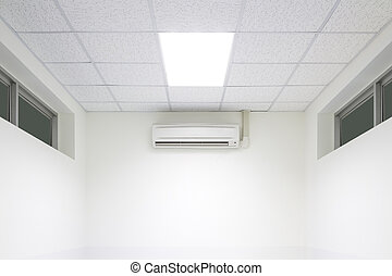 air conditioner machine in white room.