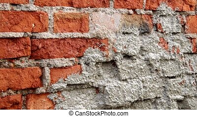 Bricks - Repairing an old brick wall with plaster