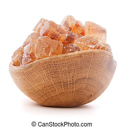 Brown cane caramelized lump sugar in wooden bowl isolated on...