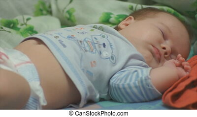 baby fast asleep in bed closeup - newborn baby sleeping...