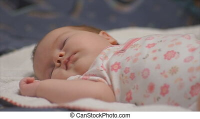 infant baby during sleep - newborn baby sleeping happily on...