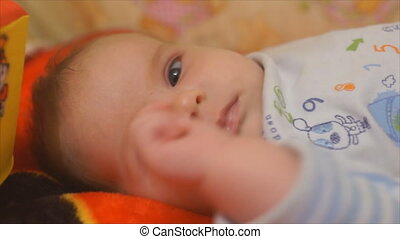 chest baby wants to sleep - Newborn baby playing with hands...